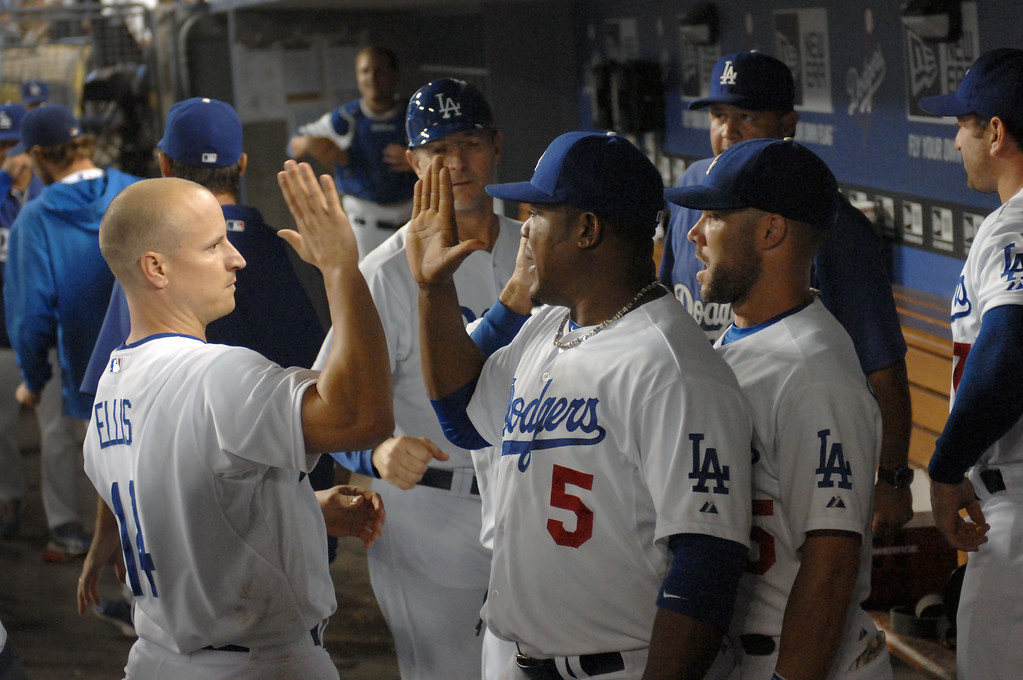 . Dodgers third baseman Juan Uribe (#5) is congratulated by Mark Ellis after fielding two hard grounders in the fifth inning against the Red Sox Friday, August 23, 2013. (Michael Owen Baker/L.A. Daily News)