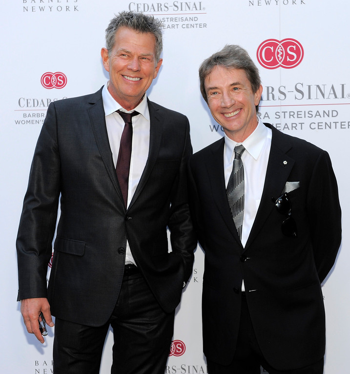 . Music producer David Foster and actor Martin Short mingle at the dedication of the Barbra Streisand Women\'s Heart Center in the Cedars-Sinai Heart Institute, on Thursday June 14, 2012 at Streisand\'s home in Malibu, Calif. (Photo by Chris Pizzello/Invision/AP)