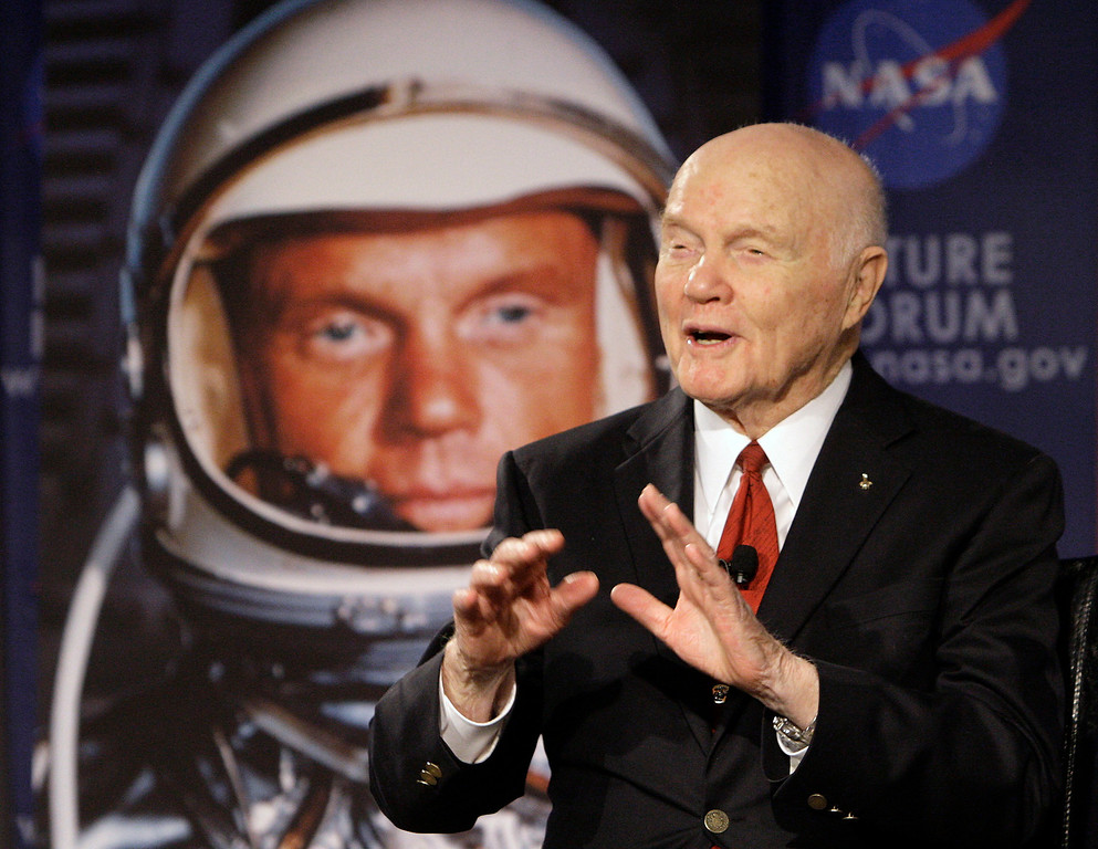 . FILE - In this Feb. 20, 2012, file photo, U.S. Sen. John Glenn talks with astronauts on the International Space Station via satellite in Columbus, Ohio. Changing Port Columbus� name to John Glenn Columbus International Airport will cost an estimated $775,000 in new signs, according to a newly released study. The airport was named in honor of the astronaut and former U.S. senator in June 2016. The 95-year-old Ohio native was the first American to orbit the earth. (AP Photo/Jay LaPrete, File)