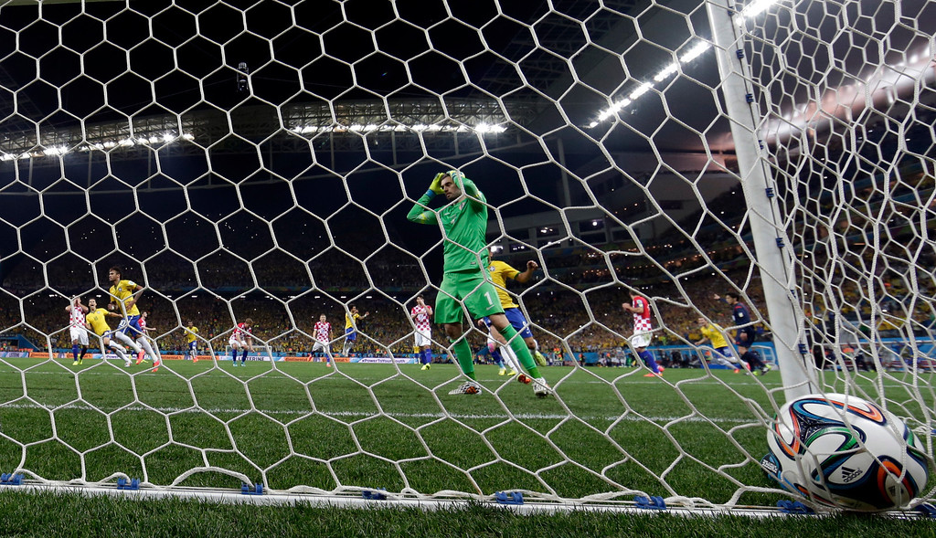 . Croatia\'s goalkeeper Stipe Pletikosa holds his head after Brazil\'s Neymar scored from the penalty spot during the group A World Cup soccer match between Brazil and Croatia, the opening game of the tournament, in the Itaquerao Stadium in Sao Paulo, Brazil, Thursday, June 12, 2014.  (AP Photo/Andre Penner)