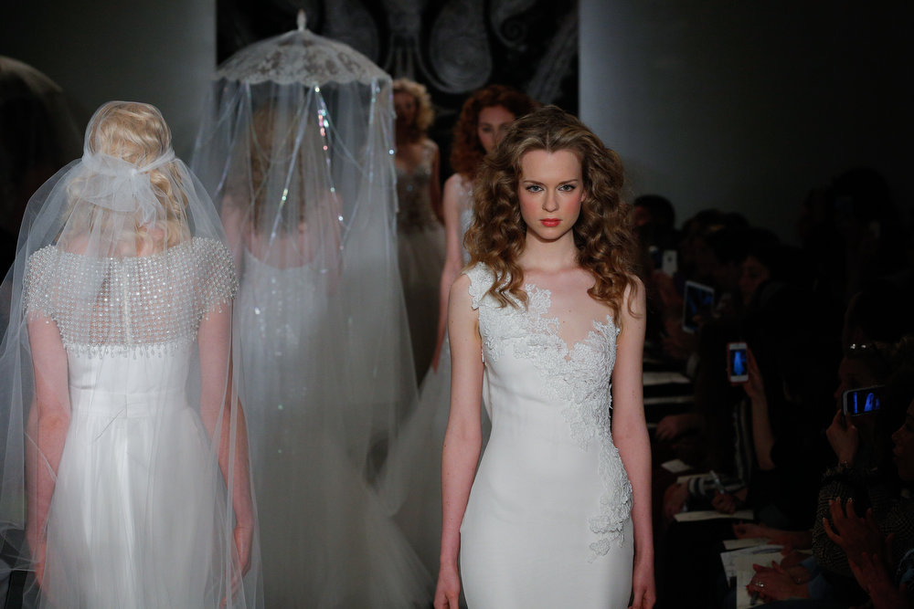 . Models walk the runway during the Reem Acra 2014 Bridal Spring/Summer collection show on April 20, 2013 in New York City.  (Photo by JP Yim/Getty Images)