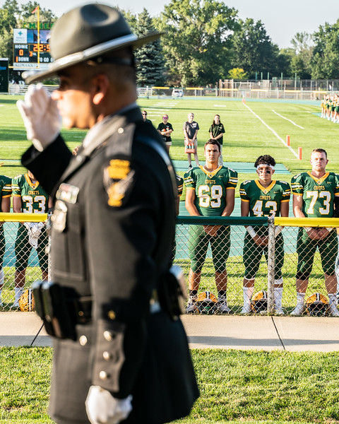 Son of fallen officer Kenny Velez Christian Velez and his teamates take a moment as they raise the flag in honor of his father-3.jpg