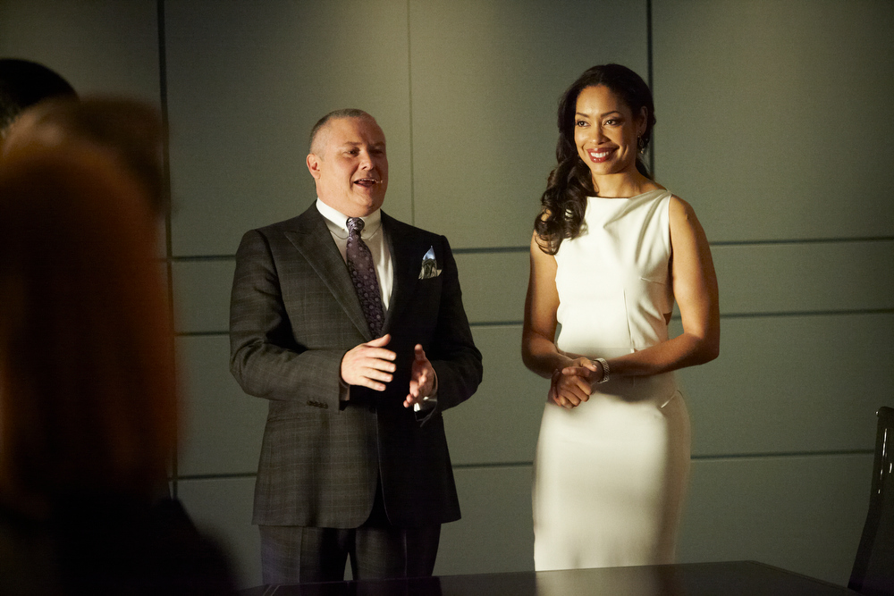""". SUITS -- \""""The Arrangement\"""" Episode 301 -- Pictured: (l-r) Conleth Hill as Edward Darby, Gina Torres as Jessica Pearson -- (Photo by: Ian Watson/USA Network)"""