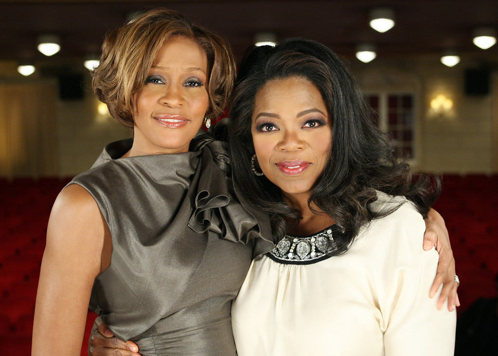 . In this Aug. 31, 2009, photo provided by Harpo Productions, television talk-show host Oprah Winfrey poses with Whitney Houston at the Town Hall in New York.  (AP Photo/Harpo Productions, George Burns)