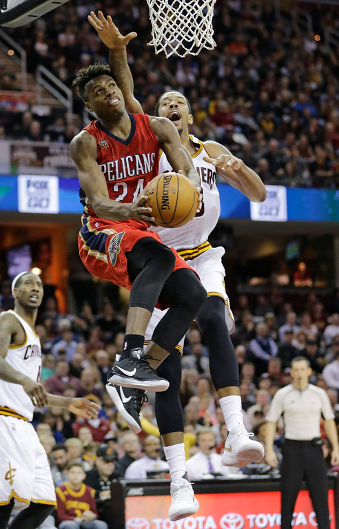 . New Orleans Pelicans\' Buddy Hield (24), from Bahamas, drives to the basket against Cleveland Cavaliers\' Channing Frye (8) in the second half of an NBA basketball game, Monday, Jan. 2, 2017, in Cleveland. The Cavaliers won 90-82. (AP Photo/Tony Dejak)