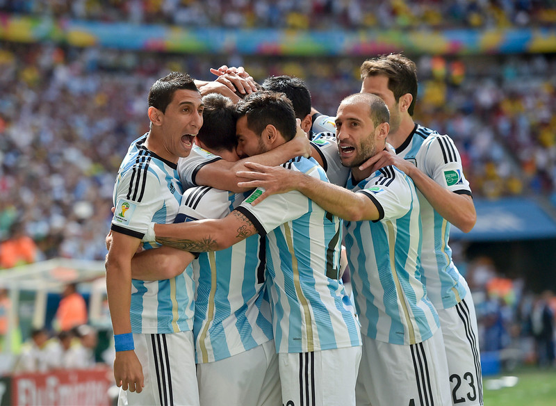 . Argentina players celebrate after Gonzalo Higuain scored the opening goal during the World Cup quarterfinal soccer match between Argentina and Belgium at the Estadio Nacional in Brasilia, Brazil, Saturday, July 5, 2014. (AP Photo/Martin Meissner)
