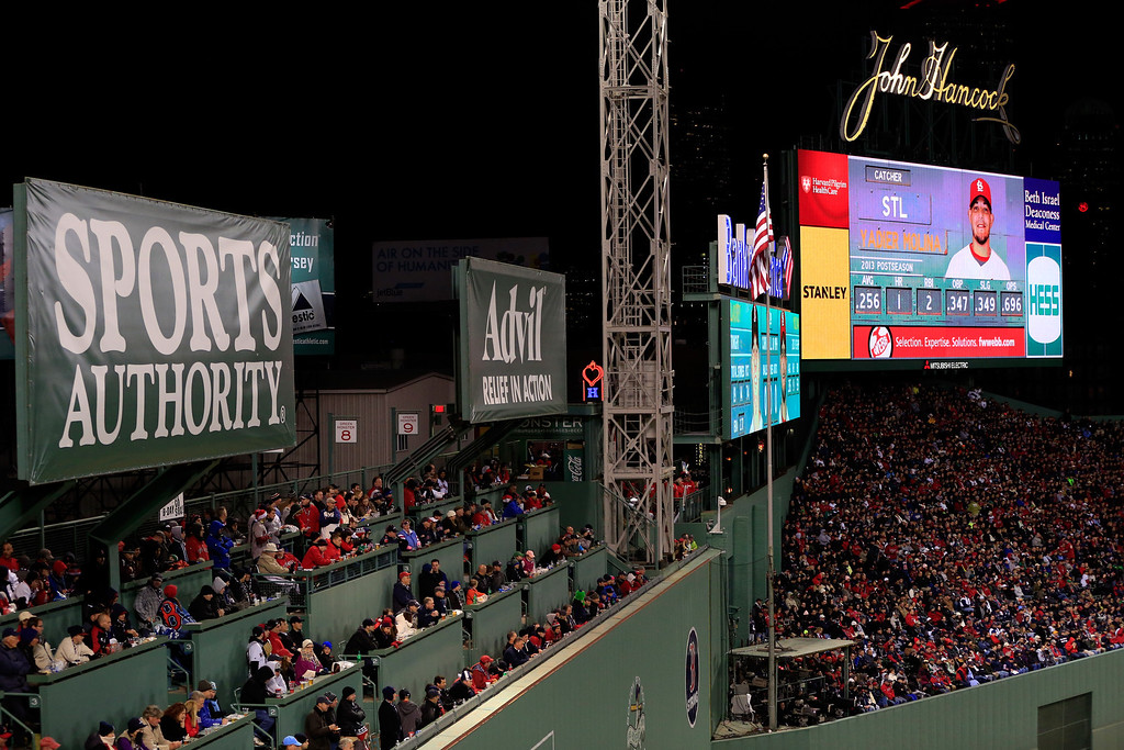 . Fans watch from the Green Monster during Game Two of the 2013 World Series between the Boston Red Sox and the St. Louis Cardinals at Fenway Park on October 24, 2013 in Boston, Massachusetts.  (Photo by Jamie Squire/Getty Images)