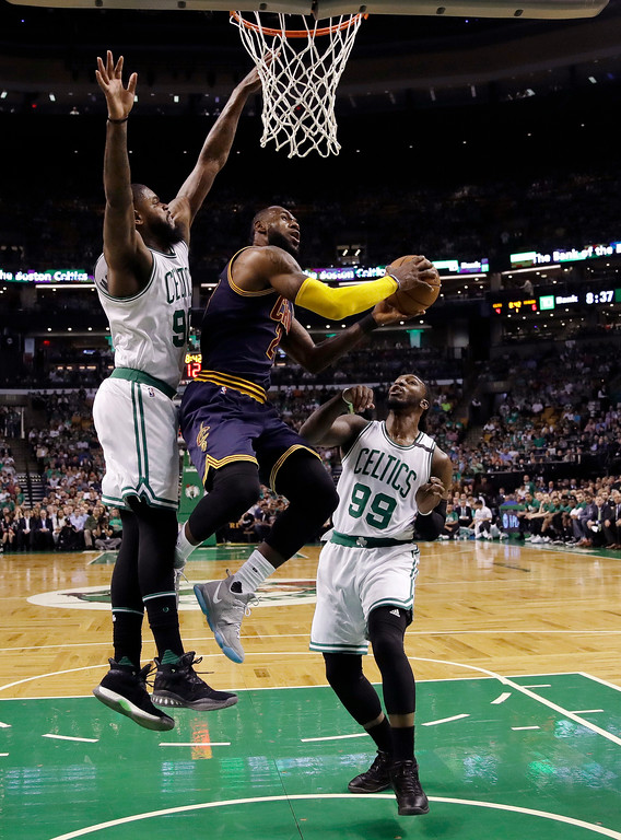 . Cleveland Cavaliers forward LeBron James drives between Boston Celtics forwards Amir Johnson, left, and Jae Crowder during the first quarter of Game 1 of the NBA basketball Eastern Conference finals, Wednesday, May 17, 2017, in Boston. (AP Photo/Charles Krupa)