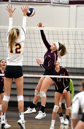 11/14/2019 Mike Orazzi | StaffrSt. Joseph High School's Ava Tuccio (12) and Bristol Central's Jadyn Bauer (1) during the Class L Second Round Girls Volleyball Tournament at BCHS. rr