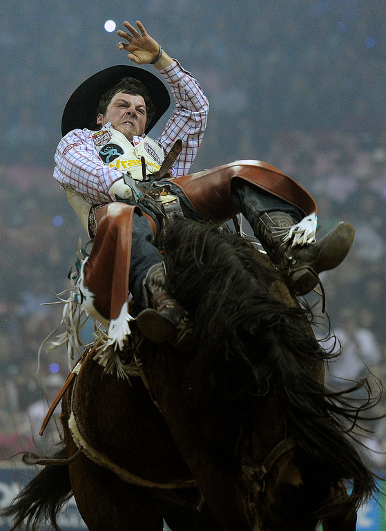 . Richmond Champion of The Woodlands, Texas competes in the bareback riding during the fifth go-round of the National Finals Rodeo at the Thomas & Mack Center on Monday, Dec. 8, 2014, in Las Vegas. (AP Photo/Las Vegas Review Journal, David Becker)