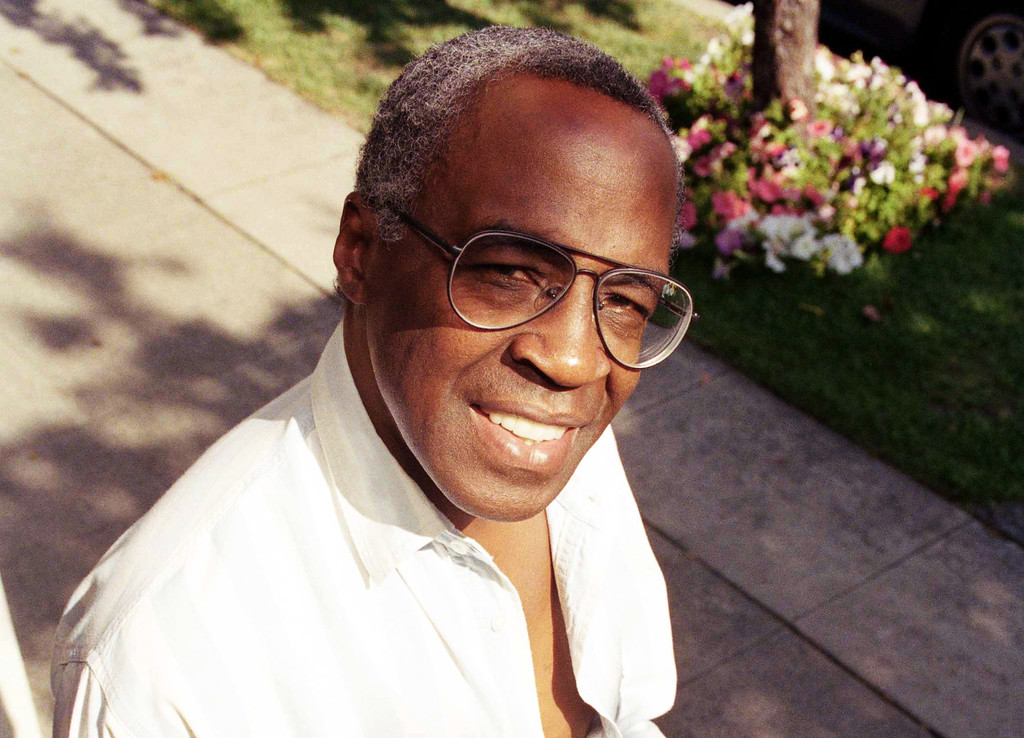. FILE - In this Sept. 4, 1991 file photo, actor Robert Guillaume poses for a portrait in Los Angeles.  Guillaume, who won Emmy Awards for his roles on �Soap� and �Benson,� died Tuesday, Oct. 24, 2017 in Los Angeles at age 89. Guillaume�s widow Donna Brown Guillaume says he had been battling prostate cancer. (AP Photo/Chris Martinez, File)