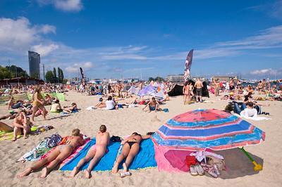 People sunbathing on sandy beach, Baltic Sea, Gdynia, Poland