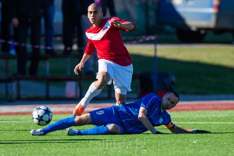 Mihails Zizilevs (9) stops Duvan Castaneda (21) of FK Spartaks