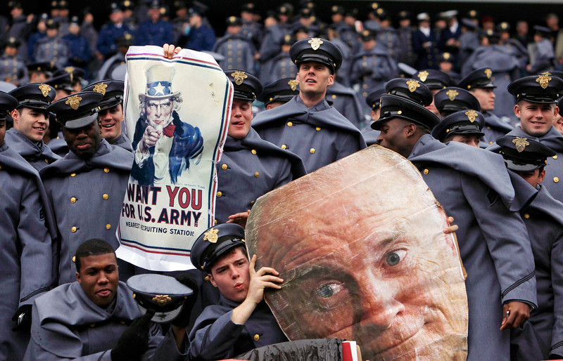 . Army Cadets cheer in the stands with a cut out of Vice President Joe Biden before the start of the 113th Army-Navy football game in Philadelphia, Saturday, Dec. 8, 2012. (AP Photo/Jacqueline Larma)