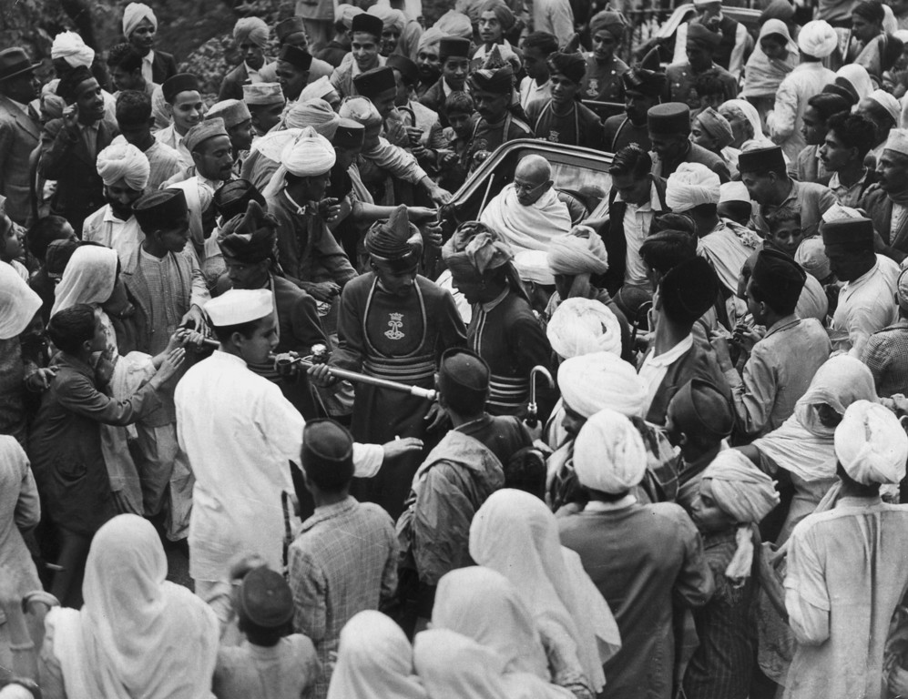 . Indian nationalist leader and thinker Mahatma Gandhi (Mohandas Karamchand Gandhi) on his way by rickshaw to the Viceregal Lodge to meet the Viceroy of India, 27th August 1940.  (Photo by Fox Photos/Getty Images)