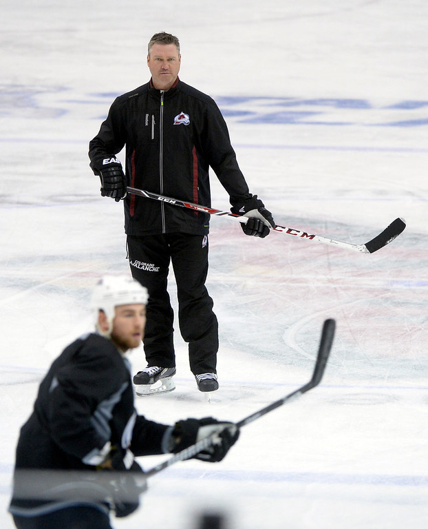 . Coach Patrick Roy watched Ryan O\'Reilly during practice Wednesday. The Colorado Avalanche practiced  at the Xcel Energy Center in St. Paul Wednesday afternoon, April 23, 2014. (Photo by Karl Gehring/The Denver Post)