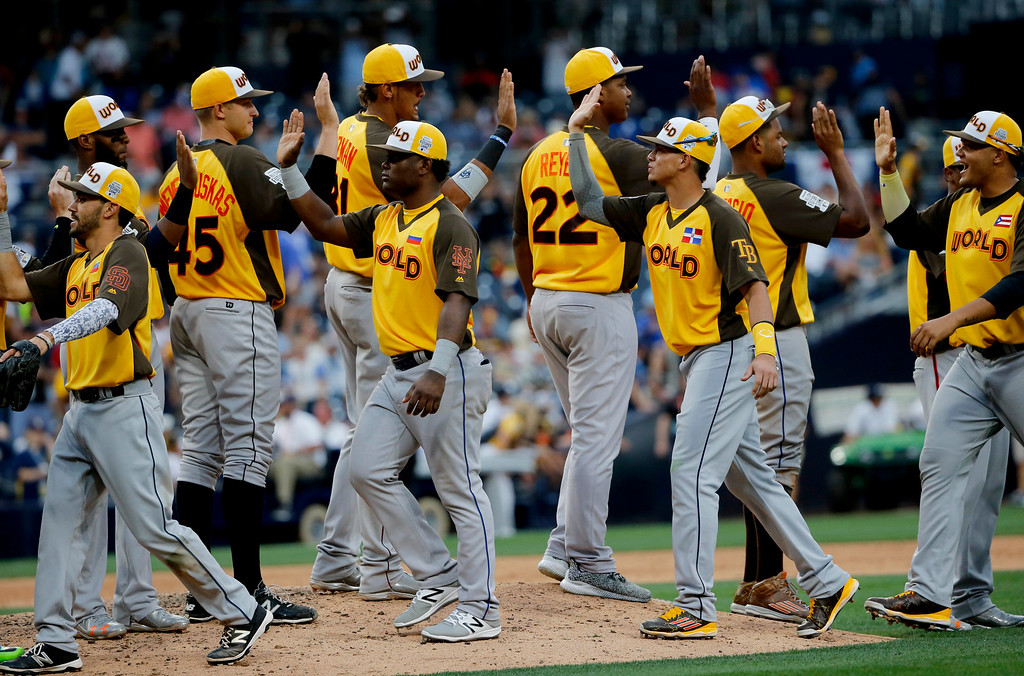 . The World Team celebrates their 11-3 win after the All-Star Futures baseball game against the U.S. Team, Sunday, July 10, 2016, in San Diego. (AP Photo/Lenny Ignelzi)