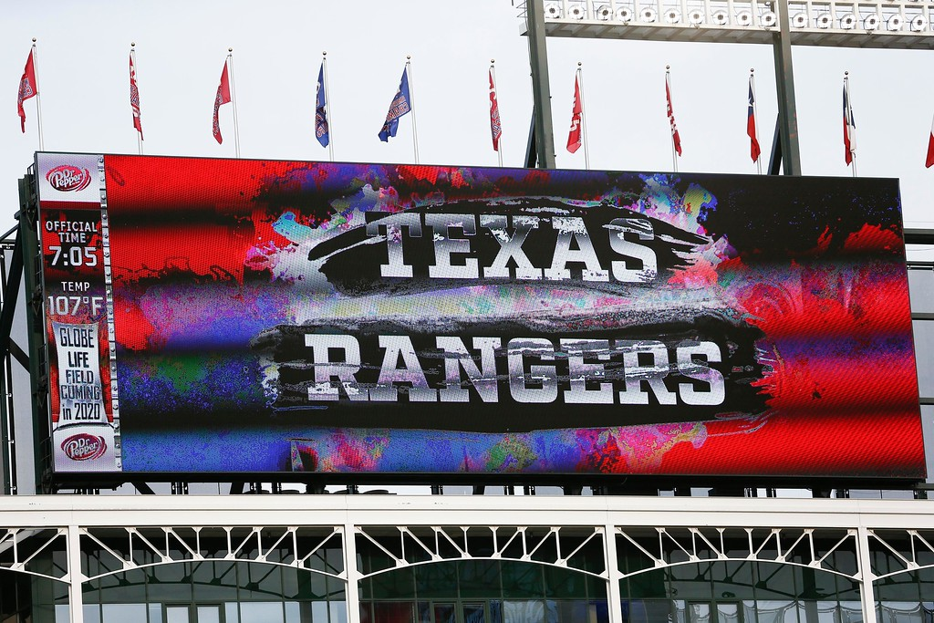 . The scoreboard at Globe Life Park showing the game temperature of 107 degrees at the start of the baseball game between the Texas Rangers and the Cleveland Indians, Friday, July 20, 2018, in Arlington, Texas. (AP Photo/Jim Cowsert)