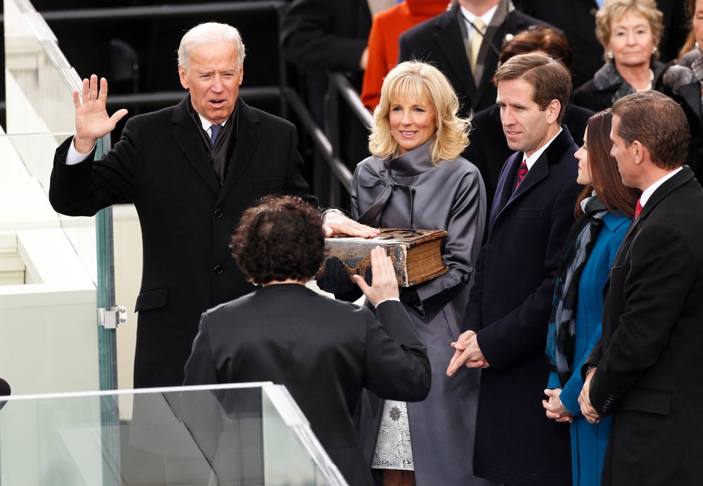 Description of . Vice President Joe Biden (L) takes the oath from Supreme Court of the US Justice Sonya Sotomayor (2nd L)  as Biden's wife Dr. Jill Biden holds the bible during swearing-in ceremonies on the West front of the U.S Capitol in Washington, January 21, 2013.  REUTERS/Kevin Lamarque
