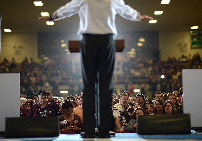 . Supporters listen to US Republican Presidential candidate Mitt Romney during a rally at the Veterans Memorial Coliseum in Marion, Ohio, October 28, 2012. AFP PHOTO/Emmanuel  DUNAND/AFP/Getty Images