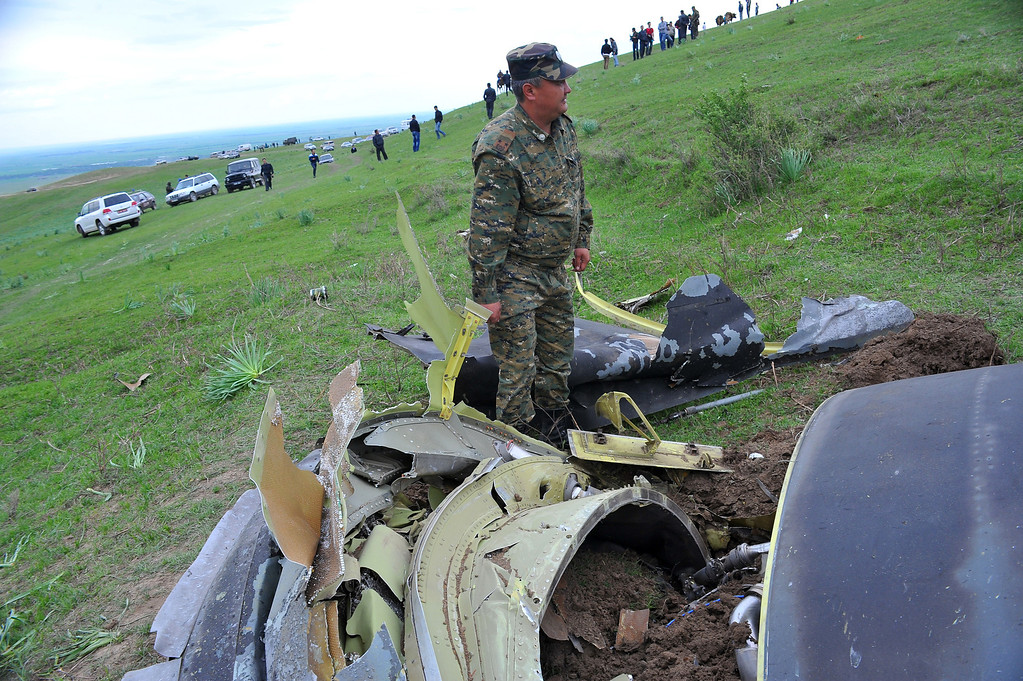 . A soldier stands near the debris of a crashed US KC-135 Stratotanker plane are seen on a hill near the villages of Chorgolo and Cholok-Aryk, 180 km from the Kyrgyzstan�s capital Bishkek, on May 3, 2013. AFP PHOTO/ STRINGER/AFP/Getty Images