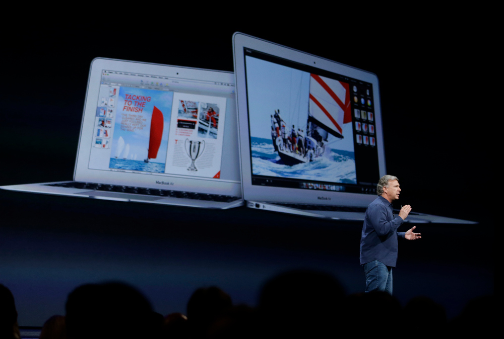 . Phil Schiller the senior vice president of worldwide marketing at Apple introduces the new MacBook Air laptops during the keynote address of the Apple Worldwide Developers Conference Monday, June 10, 2013 in San Francisco. (AP Photo/Eric Risberg)