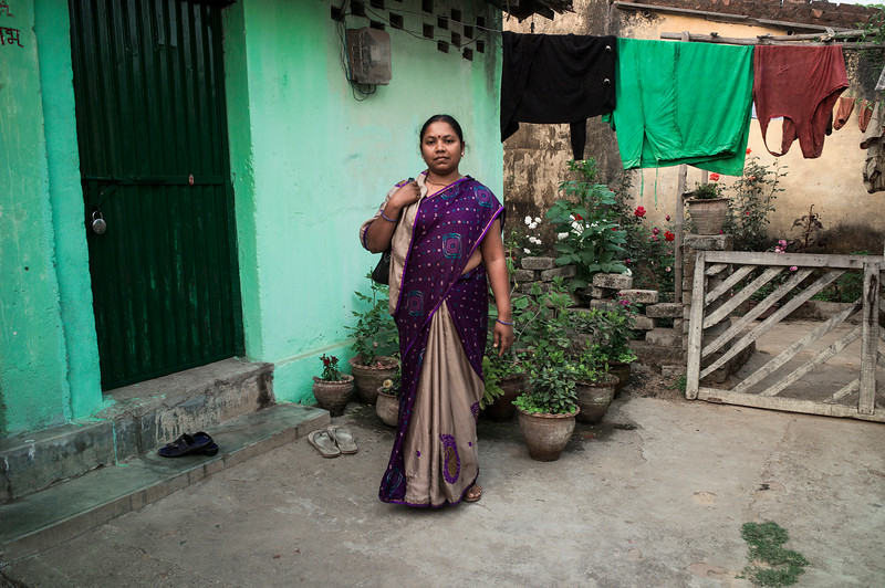 Chattisgarh, India, February 2015:   Nurse Tarika Lakra from Tamnar, who lost her land to Jindal Steel and Power Limted, poses for a photograph in front of her apartment provided by her hospital.   Photographs for a story on land allocation for coal mines in Chattisgarh.  Modi's new government in the centre has relaxed the environmental regulations so the land can be allocated to both public and private sector companies easily.   Photo by Sami Siva for Al Jazeera America.