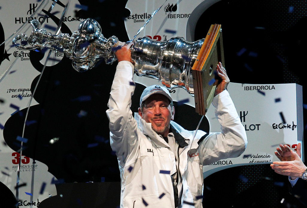 . BMW Oracle Racing owner Larry Ellison raises the America\'s Cup trophy after winning the 33rd edition of the sailing classic against Alinghi in Valencia, Spain, on Sunday, Feb. 14, 2010. (AP Photo/Alberto Saiz)