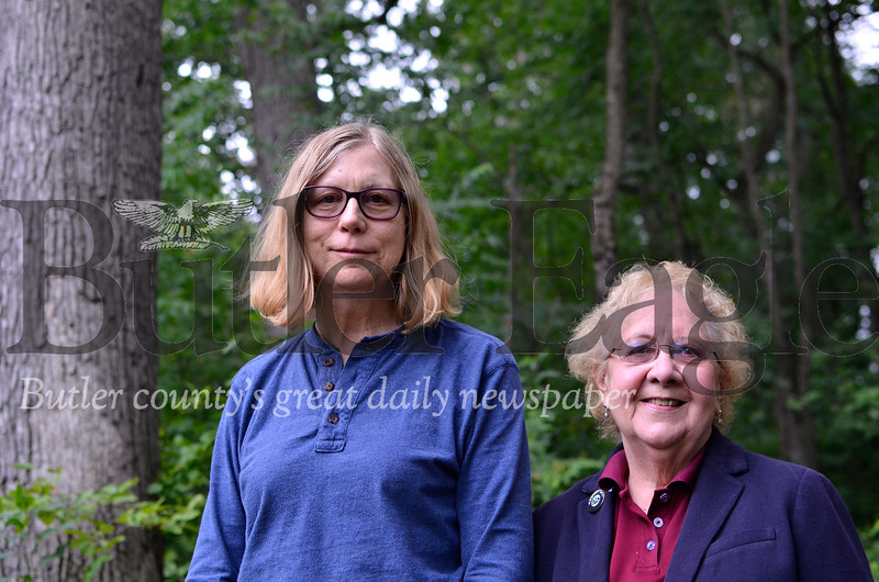Sandra Simpson, left, and borough council member Pat Rinebolt stand in borough-owned land at 416 Aderhold Road. The pair both live near the lot, which is called Roebling Park, and advocated for its continued future as a green-space.