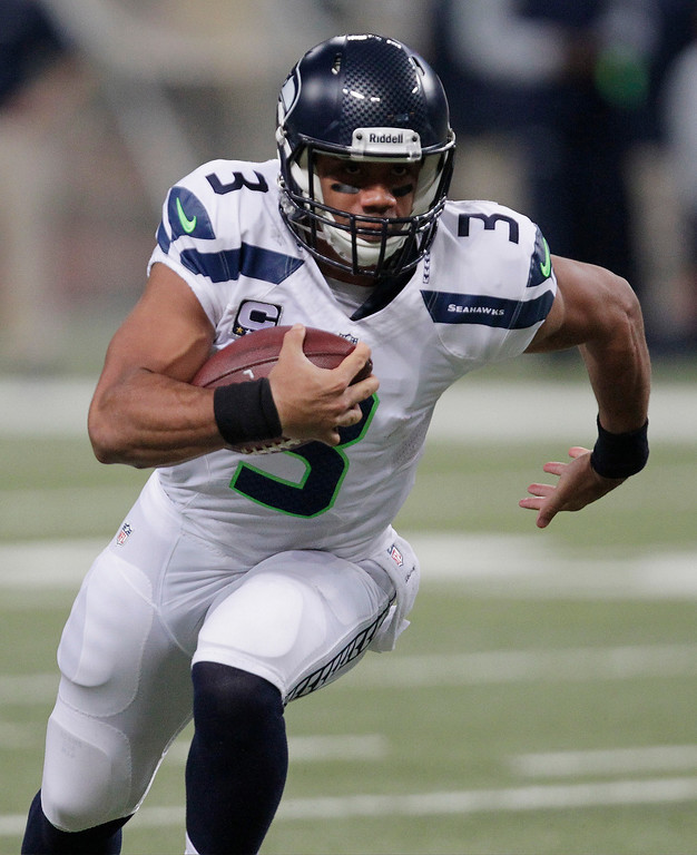 . Seattle Seahawks quarterback Russell Wilson (3) rushes against the St. Louis Rams defense during the first half of an NFL football game, Monday, Oct. 28, 2013, in St. Louis. (AP Photo/Tom Gannam)