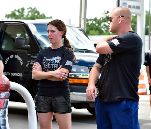 6/6/2019 Mike Orazzi | Staff Bristol Police officers Katie Grahn and Zach Levine during the Bristol Police section of the annual Law Enforcement Torch Run along Route 6 in Bristol Thursday afternoon.