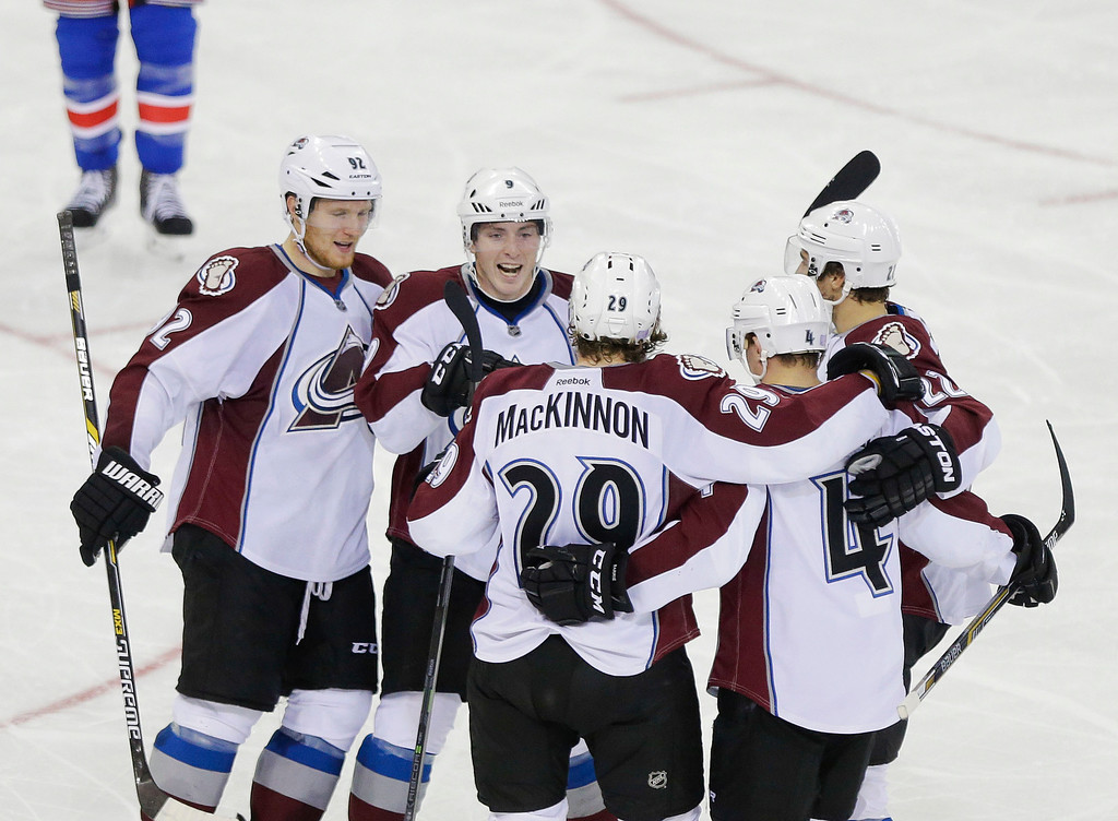 . Colorado Avalanche center Nathan MacKinnon (29) celebrates with Gabriel Landeskog (92), Matt Duchene (9) and other teammates after scoring a goal during the third period of an NHL hockey game against the New York Rangers, Thursday, Nov. 13, 2014. The Colorado Avalanche won 4-3 in a shootout. (AP Photo/Frank Franklin II)