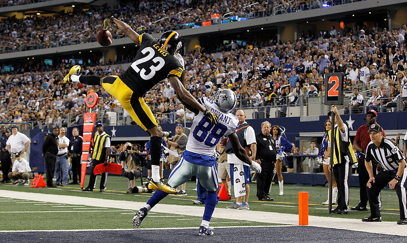 . Keenan Lewis #23 of the Pittsburgh Steelers breaks up a pass intended for Dez Bryant #88 of the Dallas Cowboys in the end zone at Cowboys Stadium on December 16, 2012 in Arlington, Texas. The Dallas Cowboys beat the Pittsburgh Steelers 27-24. (Photo by Tom Pennington/Getty Images)