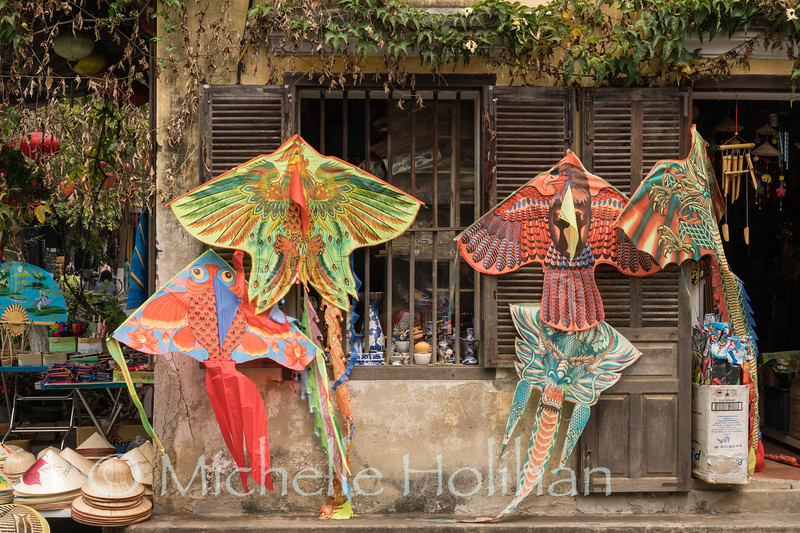 HOI AN, VIETNAM - MARCH 6, 2019: Kites and other merchandise for sale in the Old City.