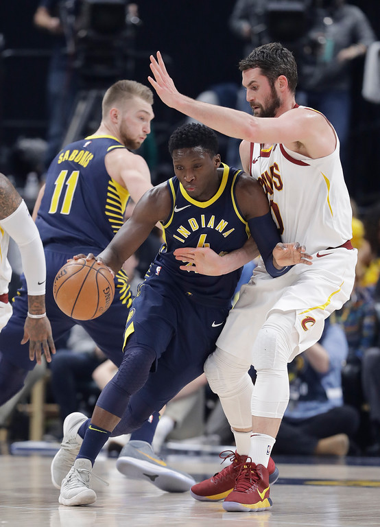 . Indiana Pacers\' Victor Oladipo (4) is defended by Cleveland Cavaliers\' Kevin Love during the first half of an NBA basketball game, Friday, Jan. 12, 2018, in Indianapolis. (AP Photo/Darron Cummings)