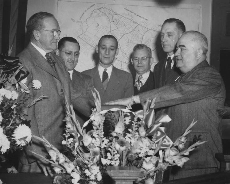 L-R,  William Friberger (township clerk), Robert Ostertag, Koloman Kiss, Robert Lacky, Joseph Kitchell, Mayor F. Edward Biertuempfel, Reorganization Day late 40's.
