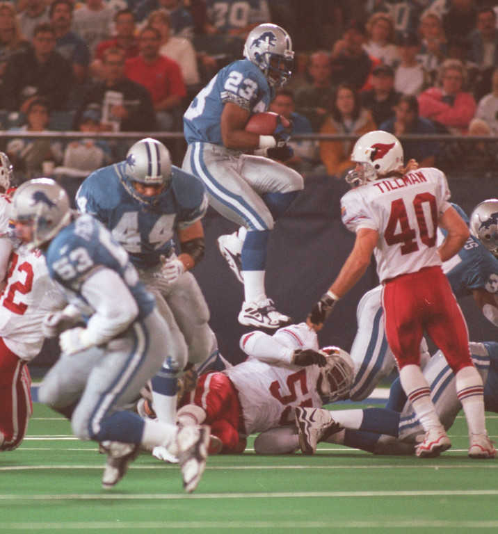 . Detroit Lions return man  Terry Fair goes up and over the coverage team.  The Arizonia Cardinals beat the Detroit Lions 17-15 in the Pontiac Silverdome.