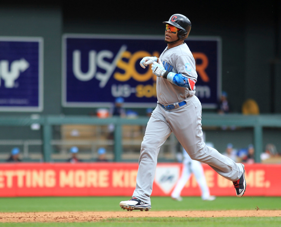 . Cleveland Indians Edwin Encarnacion rounds the bases after a two-run home run against the Minnesota Twins in the fourth inning of a baseball game on Sunday, June 18, 2017 in Minneapolis. (AP Photo/Andy Clayton-King)