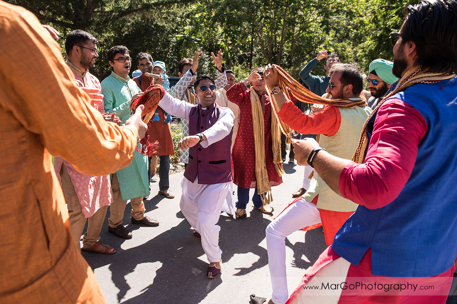 Indian men dancing during Baraat Swagat at Elliston Vineyards in Sunol