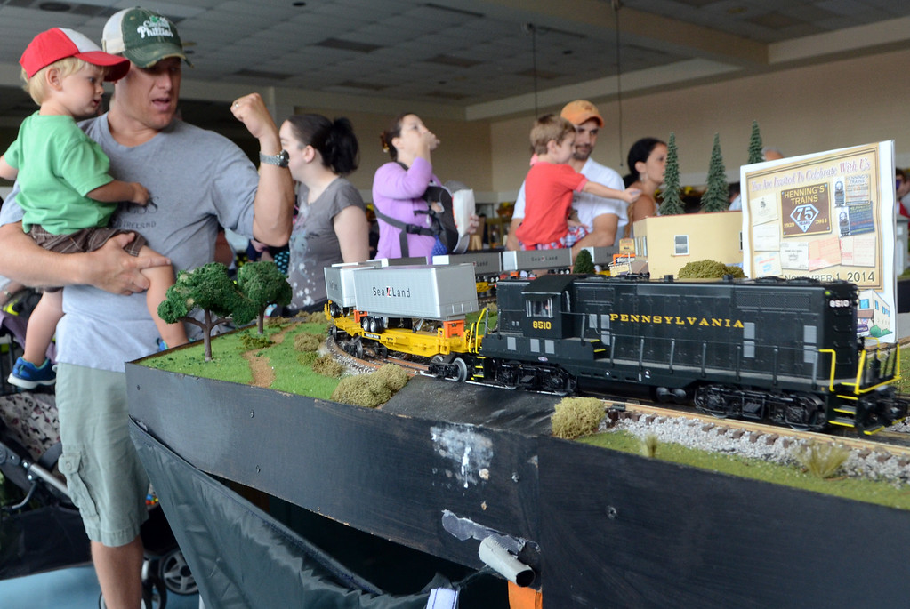 . A model train display is checked out at an open house of the Fairmount Fire Company during the Lansdale Founders Day  celebration on Saturday August 23,2014. Photo by Mark C Psoras/The Reporter