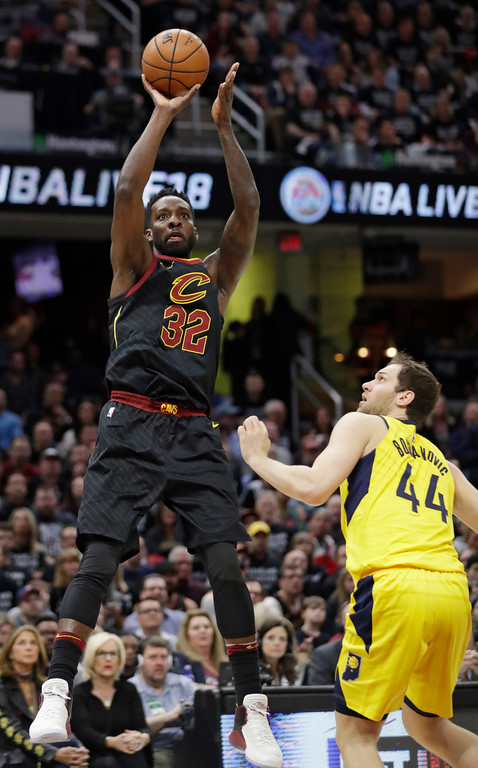 . Cleveland Cavaliers\' Jeff Green (32) shoots over Indiana Pacers\' Bojan Bogdanovic (44), from Croatia, in the first half of Game 7 of an NBA basketball first-round playoff series, Sunday, April 29, 2018, in Cleveland. (AP Photo/Tony Dejak)