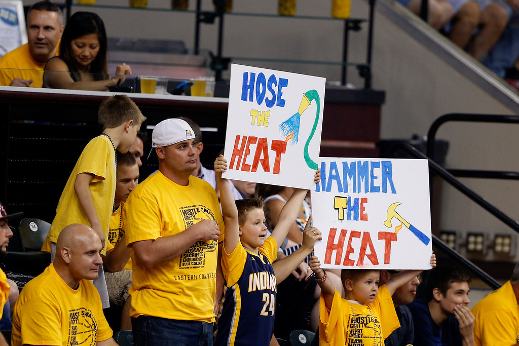 . INDIANAPOLIS, IN - MAY 28: Young Indiana Pacers fans hold up signs during Game Five of the Eastern Conference Finals of the 2014 NBA Playoffs against the Miami Heat at Bankers Life Fieldhouse on May 28, 2014 in Indianapolis, Indiana.  (Photo by Joe Robbins/Getty Images)