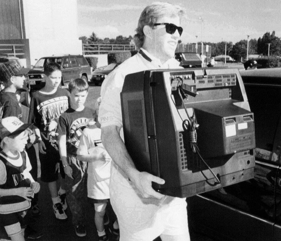. July 18, 1993: John Elway carried his television into the dormitory that would be his home for the following month during the Broncos\' training camp at the  University of Northern Colorado. (David Zalubowski, The Associated Press)