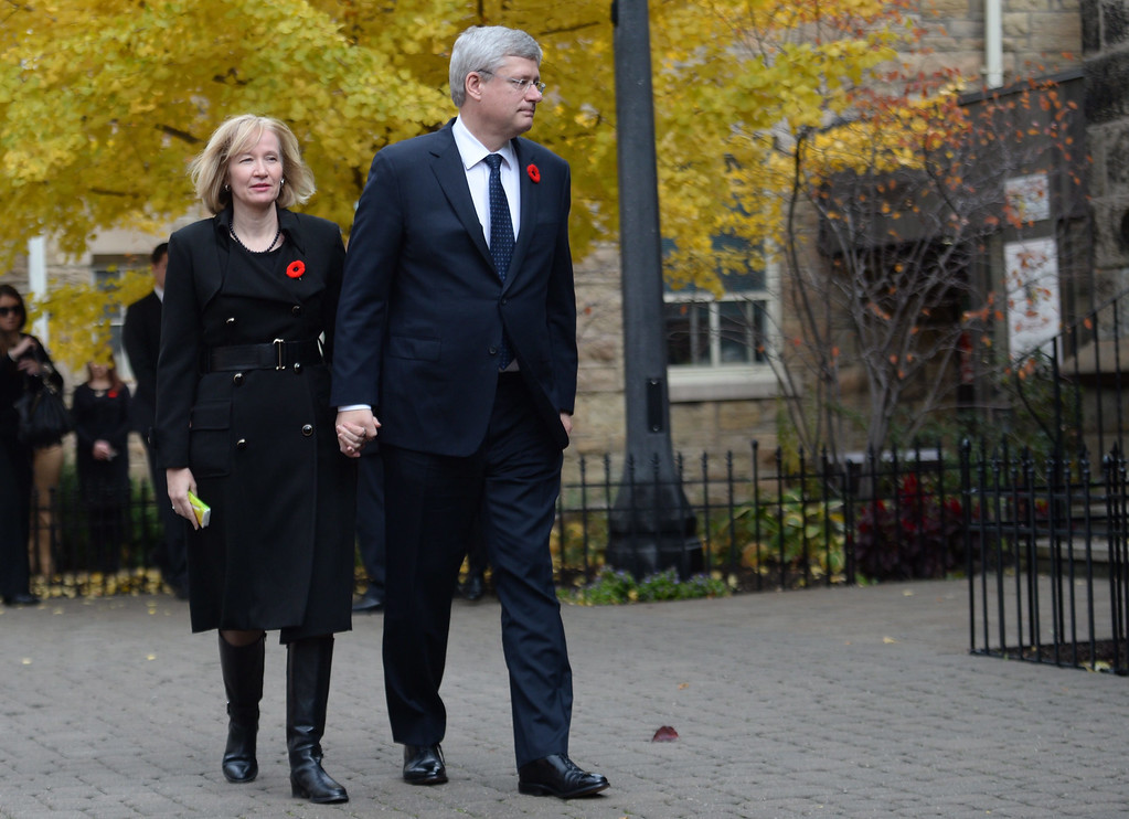 . Prime Minister Stephen Harper and his wife Laureen arrive for Cpl. Nathan Cirillo\'s funeral service in Hamilton, Ontario,  on Tuesday, Oct. 28, 2014. Cirillo was standing guard at the National War Memorial in Ottawa last Wednesday when he was killed by a gunman who went on to open fire on Parliament Hill before being shot down in a hail of bullets. Cirillo will be laid to rest in his southern Ontario hometown.   (AP Photo/The Canadian Press, Nathan Denette)