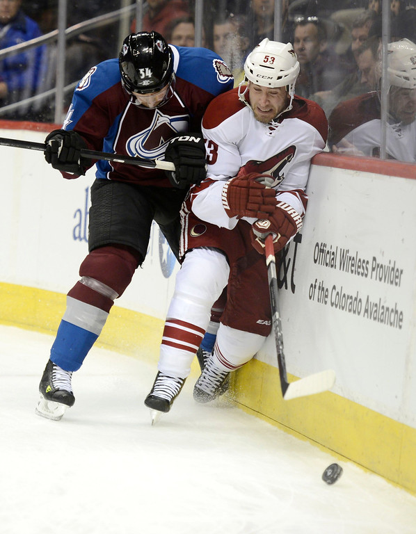 . DENVER, CO. - FEBRUARY 11: David Jones (54) of the Colorado Avalanche pounds Derek MOrris (53) of the Phoenix Coyotes in to the boards during the first period February 11, 2013 at Pepsi Center.(Photo By John Leyba/The Denver Post)