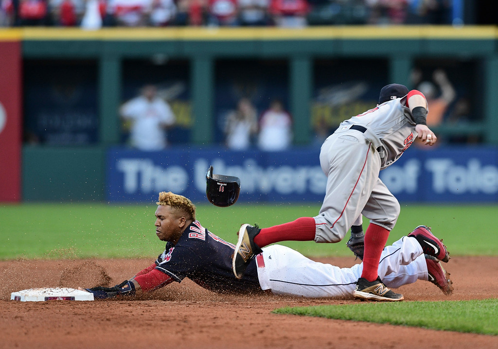 . Boston Red Sox second baseman Dustin Pedroia, right, tags out Cleveland Indians\' Jose Ramirez who was attempting to steal second in the fifth inning during Game 2 of baseball\'s American League Division Series, Friday, Oct. 7, 2016, in Cleveland. (AP Photo/David Dermer)