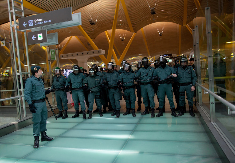 . Riot Police make a cordon during a protest of Spanish Airline Iberia staff against job cuts at Barajas Airport on February 18, 2013 in Madrid, Spain. Today is the first of a five day strike held by Iberia cabin crew, maintenance workers and ground staff in response to the planned loss of 3,800 jobs. The strike has resulted in the airline having to cancel 400 flights this week with unions planning a further five day strikes within a month.  (Photo by Pablo Blazquez Dominguez/Getty Images)