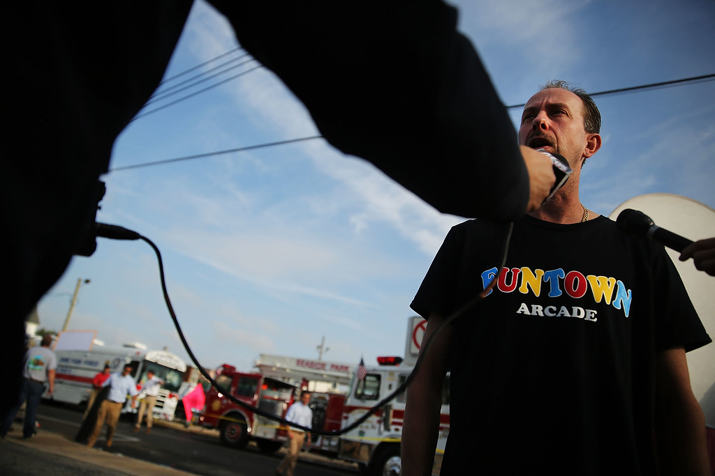 . Daniel Shauger, manager at the heavily damaged Funtown Arcade, stands at the scene of a massive fire that destroyed dozens of businesses along an iconic Jersey shore boardwalk on September 13, 2013 in Seaside Heights, New Jersey.  (Photo by Spencer Platt/Getty Images)