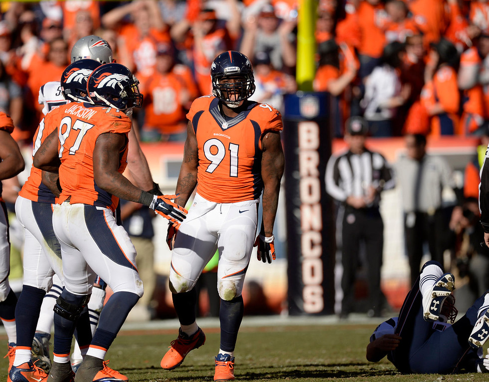 . Denver Broncos defensive end Robert Ayers (91) reacts to a play during the second quarter. The Denver Broncos vs. The New England Patriots in an AFC Championship game  at Sports Authority Field at Mile High in Denver on January 19, 2014. (Photo by Joe Amon/The Denver Post)