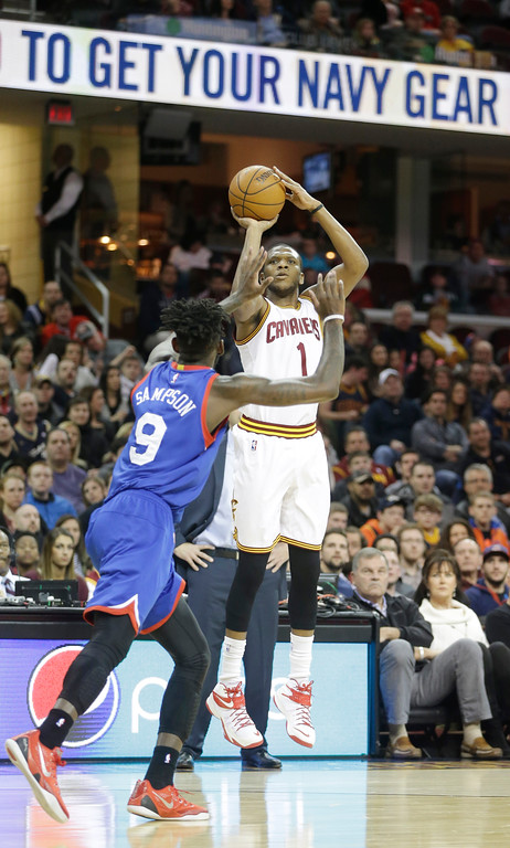 . Cleveland Cavaliers\' James Jones (1) shoots over Philadelphia 76ers\' JaKarr Sampson (9) in the first half of an NBA basketball game Sunday, March 29, 2015, in Cleveland. (AP Photo/Mark Duncan)